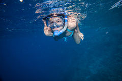 Woman with mask snorkeling. Red sea. Dark blue water Stock Photo