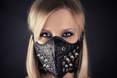 Woman in a mask with spikes. Portrait of a woman in a mask with spikes Stock Photo