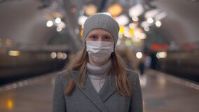 Woman in mask on subway station