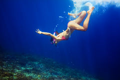 Woman with mask swimming underwater in tropical sea Royalty Free Stock Image
