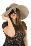 Woman mask touch hat Royalty Free Stock Image