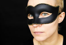 Woman in mask. Young woman in black mask on her face Stock Photos