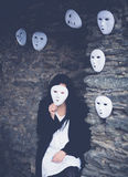 Woman with a mask. Young woman hiding behind a mask Royalty Free Stock Photo