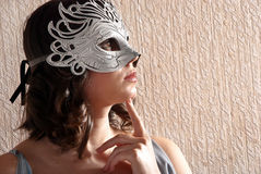 Woman in masquerade mask stock photography