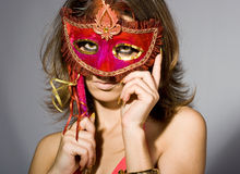 Woman with masquerade mask Royalty Free Stock Photos