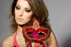 Woman with masquerade mask Stock Image