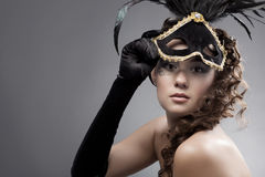 Woman with masquerade mask. Beautiful woman wearing masquerade costume and mask Stock Images