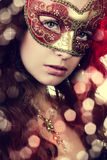 Woman in masquerade mask. Portrait of a beautiful woman in the masquerade mask close-up Royalty Free Stock Photo