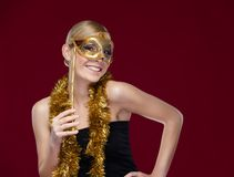 Woman with masquerade mask and tinsel Stock Image