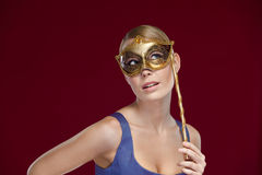 Woman with masquerade masque Stock Images
