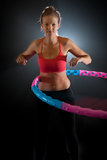 Woman with massage hula hoop Royalty Free Stock Photos