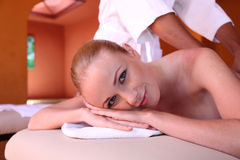 Woman in massage room Stock Image