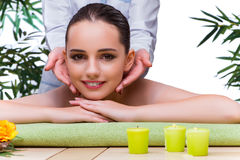 The woman during massage session in spa salon Stock Photo