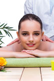 The woman during massage session in spa salon Stock Photography