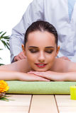 The woman during massage session in spa salon Stock Image