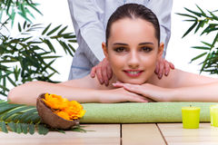The woman during massage session in spa salon Royalty Free Stock Images