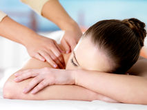 Woman on massage in spa salon. Young woman on massage in spa salon Royalty Free Stock Images