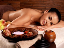 Woman after massage in spa salon. Recreation therapy for woman after massage in spa salon. Beauty treatment concept Stock Image
