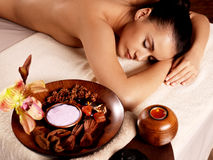 Woman after massage in spa salon Royalty Free Stock Photos