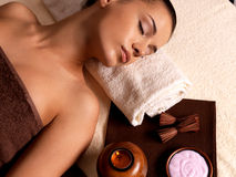 Woman after massage in spa salon. Recreation therapy for woman after massage in spa salon. Beauty treatment concept Stock Photos