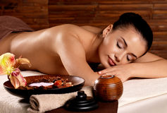 Woman after massage in spa salon. Recreation therapy for woman after massage in spa salon. Beauty treatment concept Stock Images