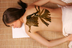 A woman at a massage spa with seaweed on her back Stock Photography