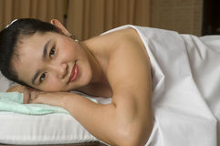 Woman on massage table Stock Images
