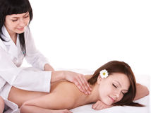Woman on massage table in beauty spa. Royalty Free Stock Photography