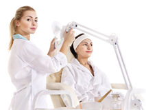 Woman on massage table in beauty spa. Stock Photo