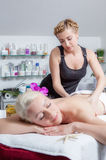 Woman on massage table in beauty spa Stock Photography