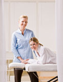 Woman and massage therapist Royalty Free Stock Photo