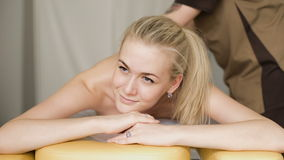 Woman in massage. Young attractive girl smiling with a massage. stock video