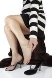 Woman massaging aching feet Stock Photos