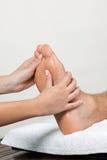 Woman Massaging Foot Stock Image