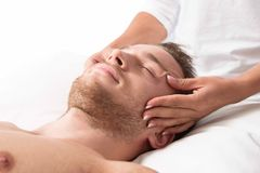 Woman massaging head Stock Photo