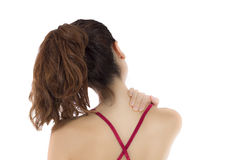 Woman massaging her aching neck and shoulders Royalty Free Stock Photos