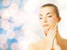 woman massaging her face Royalty Free Stock Photos