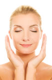 Woman massaging her face Royalty Free Stock Images