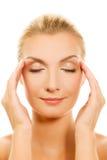 Woman massaging her head Stock Photos