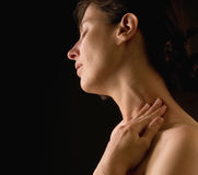 Woman massaging her neck stock photography