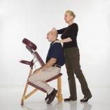 Woman massaging man. Stock Images