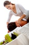 Woman massaging a man's back Stock Images