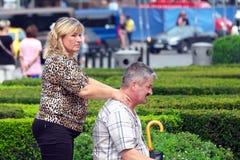 Woman massaging a man's neck Royalty Free Stock Photo