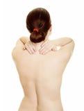 Woman massaging pain back Royalty Free Stock Photography
