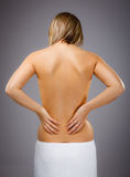 Woman massaging pain back Royalty Free Stock Photo