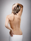 Woman massaging pain back Royalty Free Stock Photos