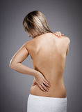 Woman massaging pain back Royalty Free Stock Image