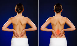 Woman massaging pain back Stock Photo