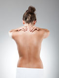 Woman massaging pain back Royalty Free Stock Images