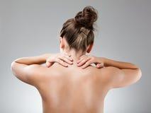 Woman massaging pain back Stock Photos